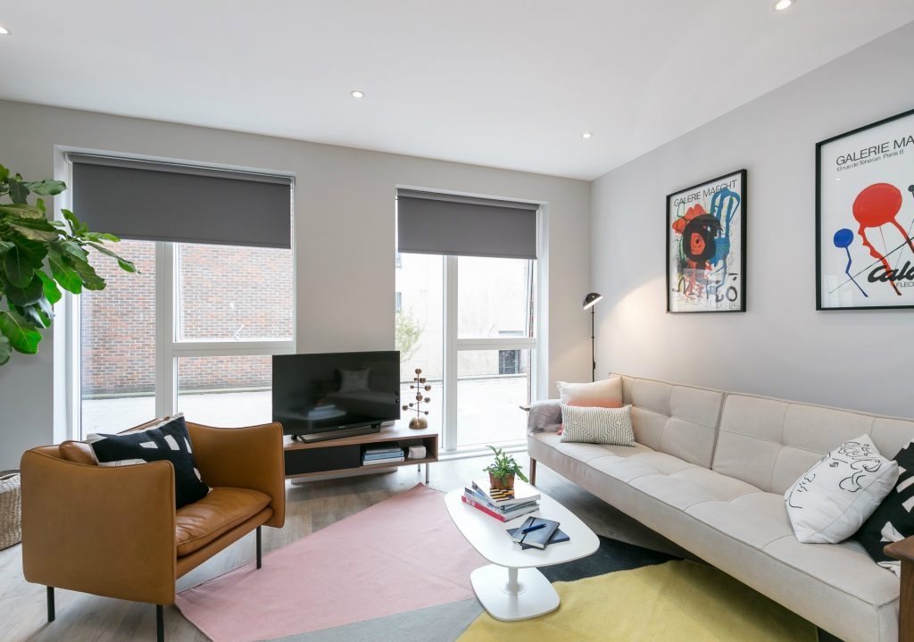living room with sofas and tv in modern apartment