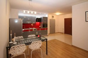 Kitchen with dining table in serviced apartment