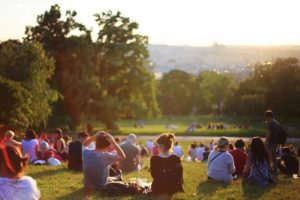 picture of young people seating in a park